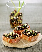 Seaweed caviar with soya oil on toasts