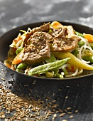 Beef and vegetables sauteed in a wok with cumin