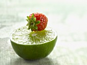 Half a lime and a strawberry