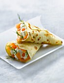 Pancake cones filled with salmon,cream and dill