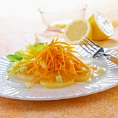 Grated carrots and potato salad with lemon juice