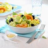 Lettuce, black olive and tomato salad