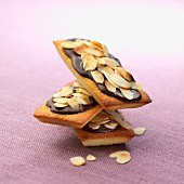 Financiers topped with chocolate and thinly sliced almonds