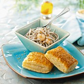 Elver and shrimp salad with sesame seed flaky pastry squares