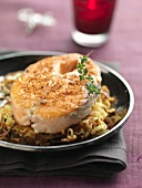 Salmon steak coated with gingerbread crumbs and potato galette with caraway