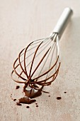 Whisk covered in chocolate Fondue