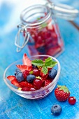 Bowl and jar of summer fruit