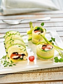 Zucchini rolls with tomato,black olive and cheese filling