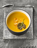 Creamed sweet potato and orange lentil soup with fried coriander