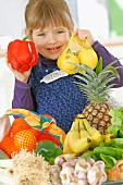 Young girl holding bags of fruit and vegetables