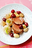 Sliced roast pork with cherries,turnips and grelot onions