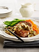 Pork chop with pureed carrots and mushrooms