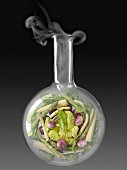 Vegetables in a glass chemical testing bottle