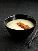 White asparagus soup with crisp Serrano ham and vanilla