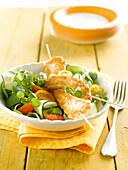 Mixed salad with crisp chicken skewers
