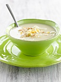 White asparagus soup with almonds and hard-boiled egg