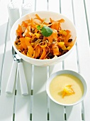 Carrot and dried fruit salad with yoghurt and orange sauce