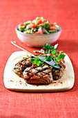Grilled veal chop with pink peppercorns