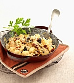 Cauliflower, olive and emmental cheese-topped dish