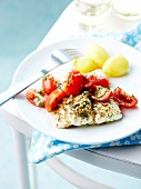 Fish fillet with tomatoes and dill