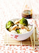 White rice,broccoli and chicken cooked in a wok