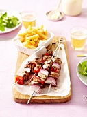 Beef,onion and red pepper skewers with french fries