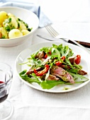 Steak with sun-dried tomatoes and rocket,sauteed potatoes with pesto