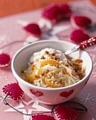 Pear and apricot fruit salad with crumbled gingerbread
