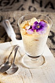 Cream of goat's milk yoghurt with pears and pansy
