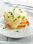 Layered potatoes, sauerkraut and orange pepper