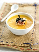 Cream of pumpkin soup with squid