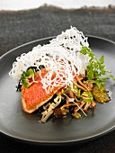 Red mullet fillets with noodles, mushrooms, passion fruit and seaweed