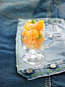 Frosted tangerine segments with basil