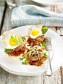 Mini horse meat burgers topped with fried quail's eggs, cheese and vegetables