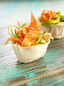 Pastry cup filled with smoked salmon and raw vegetables