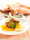 Beef with citrus fruit, pineapple and hard-boiled egg
