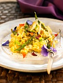 Risotto with asparagus, edible flowers and mint