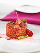 Beetroot-flavored rice with frog's legs