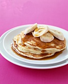 Pancakes with bananas and maple syrup