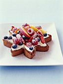 A star-shaped cake with cream and summer fruit