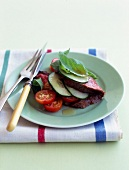 Cold roast beef with cucumber, tomato and basil salad