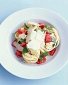 Spaghetti, tomato, parmesan, artichoke and basil salad