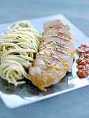 Pork filet mignon with spaghettis and herbs
