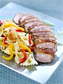Veal filet mignon and farfalles with red and yellow peppers