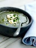 Bitter herb soup with goat's cheese Brousse