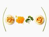 Blinis, salmon roe and parsley equation
