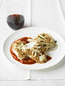 Crispy chicken breast with tomato puree and spaghettis with fried garlic and herbs