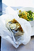 Fish with lime and herbs cooked in wax paper,pea and broad bean casserole