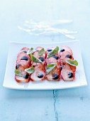 Strawberry carpaccio with balsamic vinegar and basil