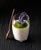Cream of parmesan with rocket pistou and purple crisp